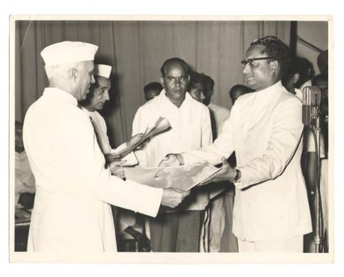 Jagat Murari (right) receives an honor from Indian Prime Minister Jawaharlal Nehru in 1956.