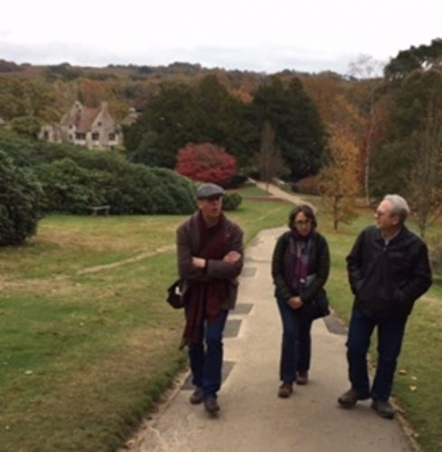Harold Brown, Anne Boyd Rioux, and David Porteus explore the grounds outside Scotney Castle.